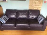 blue leather sofabed. bed is full 5 foot wide with good mattress. sofa 7 foot long