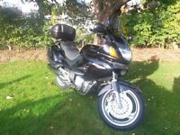 Honda Deauville NT650V. Mint condition, very low mileage, absolutely lovely bike.