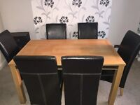 Solid Wood Dining Table And Six Leather Chairs