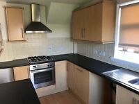 Howdens Greenwich Beech Kitchen including oven, hob, hood and integrated dishwasher