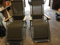 Two grey folding patio chairs buyer to collect