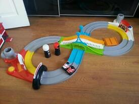 Battery operated race track with 2 cars and 2 remote controls from Mothercare