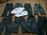 Bundle of boys grey school trousers and shorts and white polo shirts Age 4