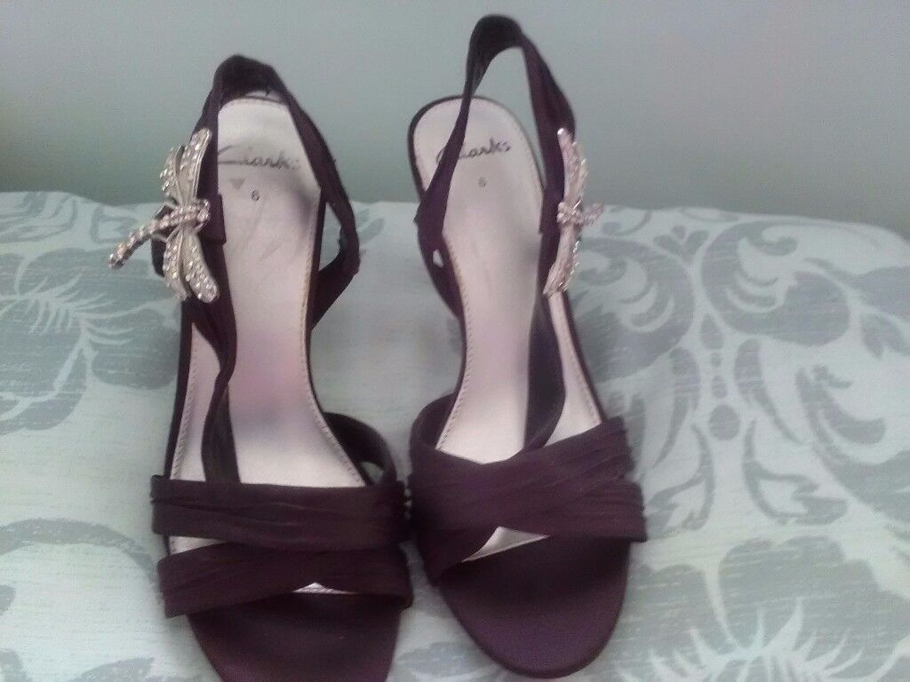 Ladies black satin shoes with rhinestone dragonfly on side excellent condition