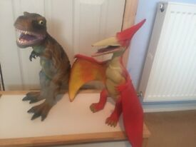 2 large toy rubber dinosaurs