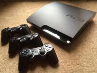 Sony PlayStation 3 - 320GB Charcoal Black Console + Extras.