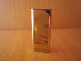 S'Elite gold coloured cigarette lighter