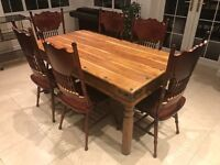 Large Solid wood dining table with 6 chairs . Solid sheesham wood and carved mahogany colour chairs