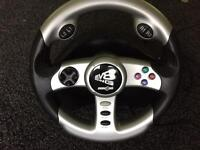 PlayStation 2 steering wheel and pedals
