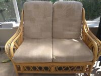Cane two seater sofa and two chairs and small round table