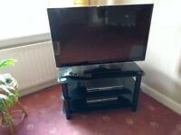 Panasonic 32 inch smart TV. Almost brand new. Glass TV stand available with TV