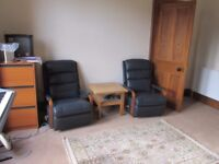 Two Lazy Boy recliners dark blue leather as new . £60 each