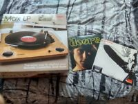 Vinyl record player conversion turntable with this two vinyls almost new.