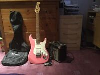 Pink electric guitar with base