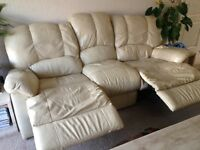 Three seater and two seater recliner sofas in cream leather, used but still plenty of life in them