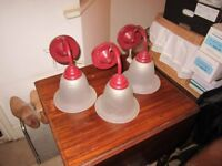 Red glass wall lamps a set of three in good condition