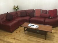 Red leater corner sofa and foot rest