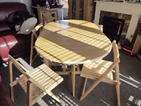 OVAL DROP LEAF DINING TABLE & 4 FOLDING CHAIRS WHICH SLIDE INTO CENTRE OF TABLE FOR STORAGE