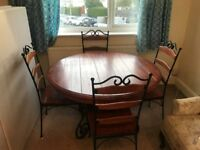 FOUR FOOT ROUND TABLE AND FOUR CHAIRS
