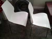 Nesting white kitchen chairs with chrome legs