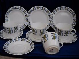TEA SET WITH MATCHING SIDE PLATES.