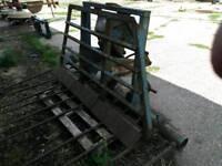 Tractor buck rake