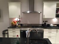 White German kitchen with 35mm black granite worktop along with all appliances