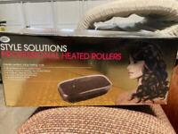 Heated hair rollers