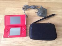 nintendo ds console with game and charger