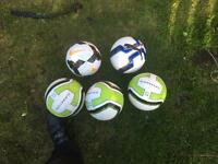 5 footballs