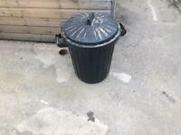 Black plastic dustbin