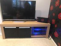 Tv stand with led light up glass shelves