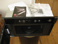 New unused microwave made by CDA model VM500SS built in wall unit