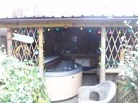 Round 5 Seater Silver Acrylic Spa Great Lakes Hot Tub and Tiki style hut