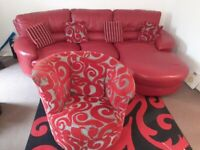 Red Leather Corner Sofa with matching Fabric Swivel Armchair.