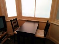 Extendable dining table + four chairs