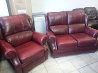 Lovely cherry leather two setter and one armchair recliner. High quality made in England.