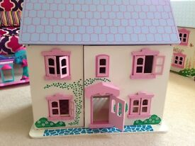 Dolls houses good condition , lid slightly damaged £35