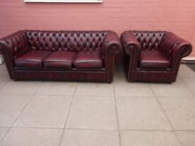 An Oxblood Red Leather Chesterfield Two Piece Suite