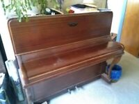 Solid, well made piano free to a good home