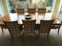 Extending Dining Room Table and 8 chairs with matching dresser