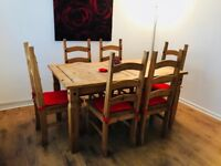 Solid oak table complete with chairs