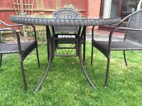 Rattan garden/patio furniture with table and 4 chairs