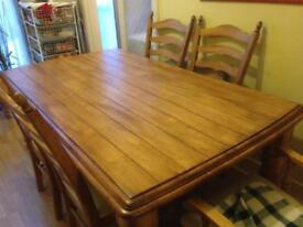 Solid oak wooden 6 seater table and chairs
