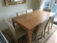 Dining table (oak colour) and 6 cream dining chairs