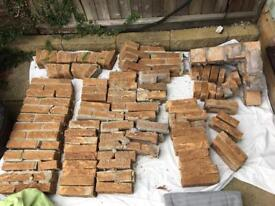 Approx 50 decorative bricks from a fireplace surround