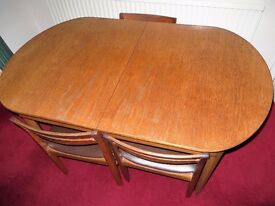 Nathan teak extending dining table & 3 chairs.