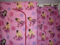 pair of curtains and wardrobe