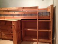 High wooden cabin bed