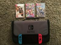 Nintendo Switch - Red/ Blue + 3x Games + Carry Case